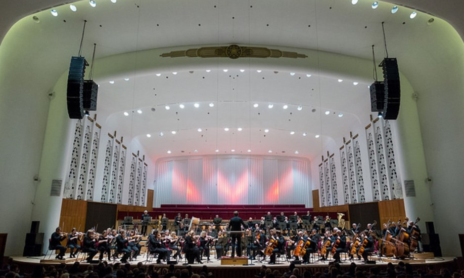 wide shot of full orchestra on stage