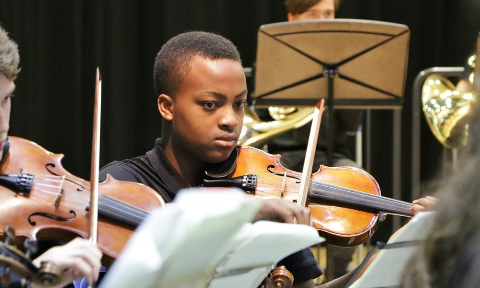 Young boy playing a violin