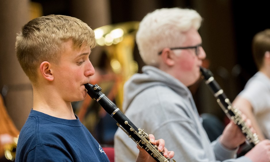 two young boys playing clarinet