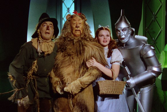 Still from Wizard of Oz film with Dorothy, Tinman, Lion and Scarecrow