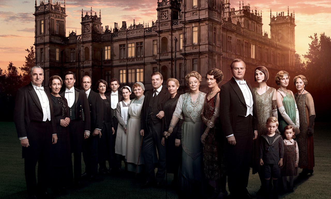 photo of cast of Downton standing outside castle